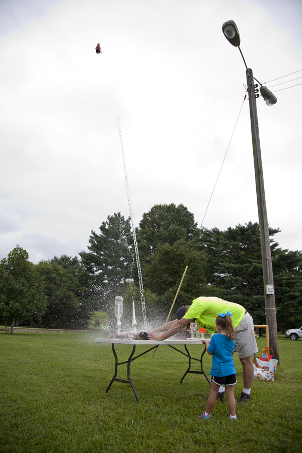 A Young girl launches a 5Alarm5K Water Rocket into the air!
